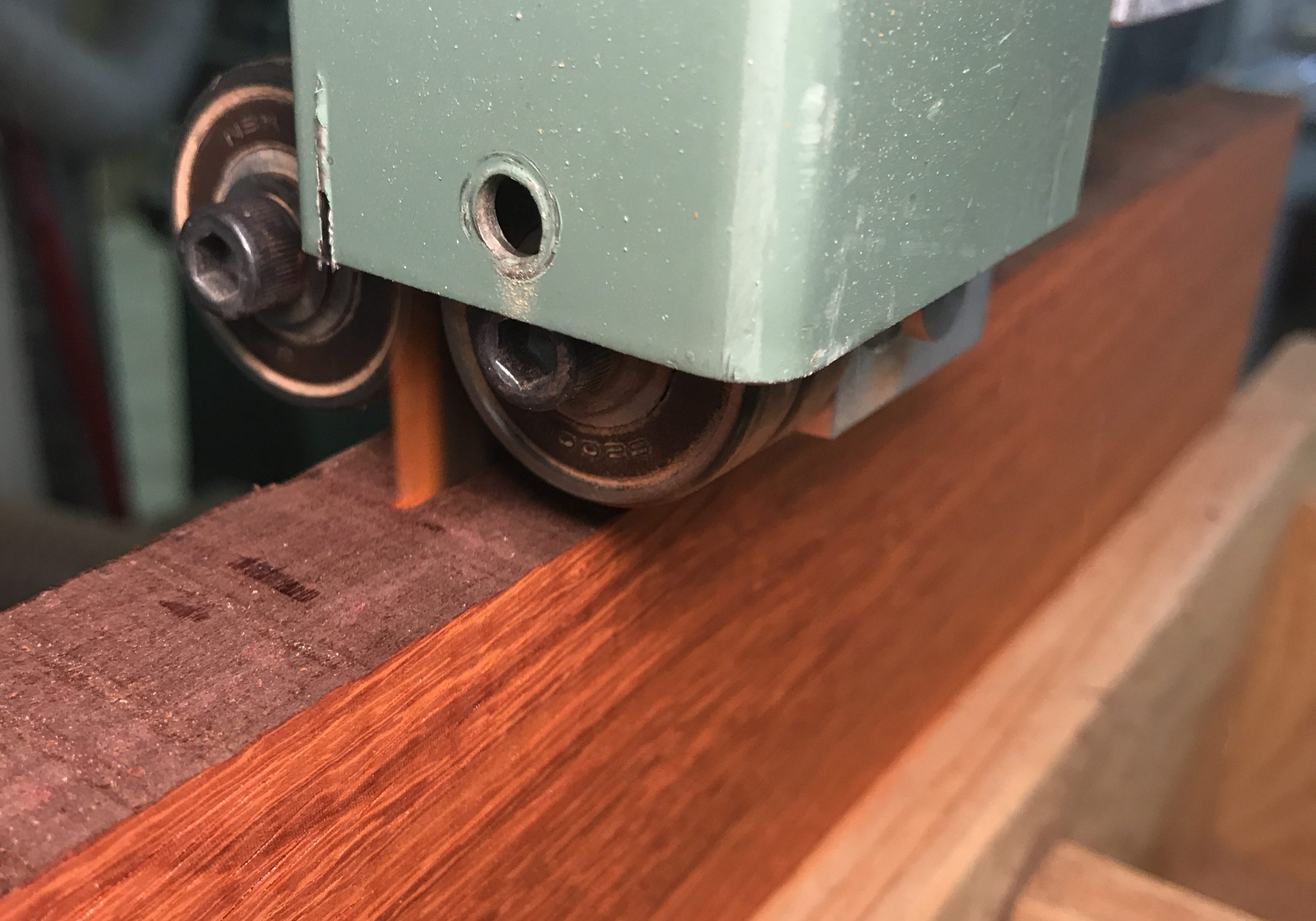 band-saw-re-sawing-lumber-red-padauk